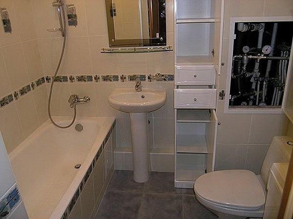 Замаскировать трубы поможет мебель в ванной