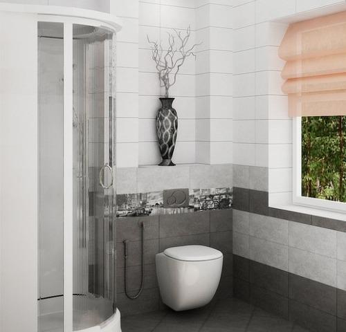 Небольшая душевая с туалетом, выполненная в серо-белых тонах